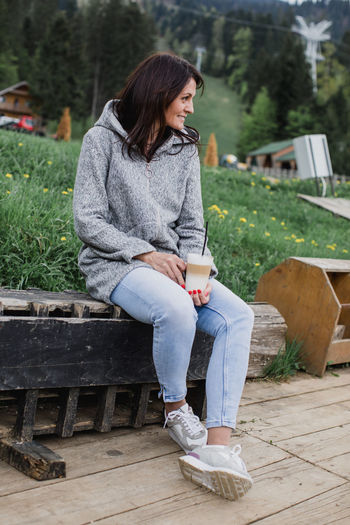 One Person Sitting Full Length Real People Young Adult Casual Clothing Lifestyles Leisure Activity Seat Young Women Day Women Architecture Adult Focus On Foreground Bench Looking Nature Outdoors Hairstyle Beautiful Woman Contemplation Teenager