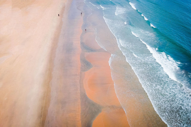 Water Sea Land Beach Beauty In Nature Motion Wave Scenics - Nature Sand Nature No People Aquatic Sport Tranquil Scene Sport Tranquility High Angle View Day Outdoors