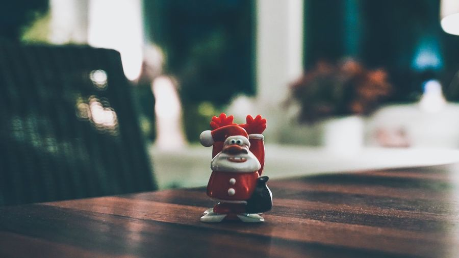 Wanted…😎 Christmas Lights Christmas Decoration Santa Claus Santa Representation Table Toy Indoors  Art And Craft Figurine  No People Creativity Human Representation Red Decoration Close-up Focus On Foreground Craft Selective Focus Single Object Small Still Life