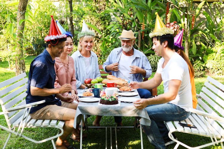 60 Barbecue BBQ Birthday Blowing Cake Candles Caucasian Dinner Eating Elderly Family Female Food Friends Fun Garden Girl Grandfather Grandpa Grandson Group Happy Home Lifestyle Man Men Old Outdoor Outdoors Party People person Senior Seniors Sitting Smiling Social Summer Together Woman