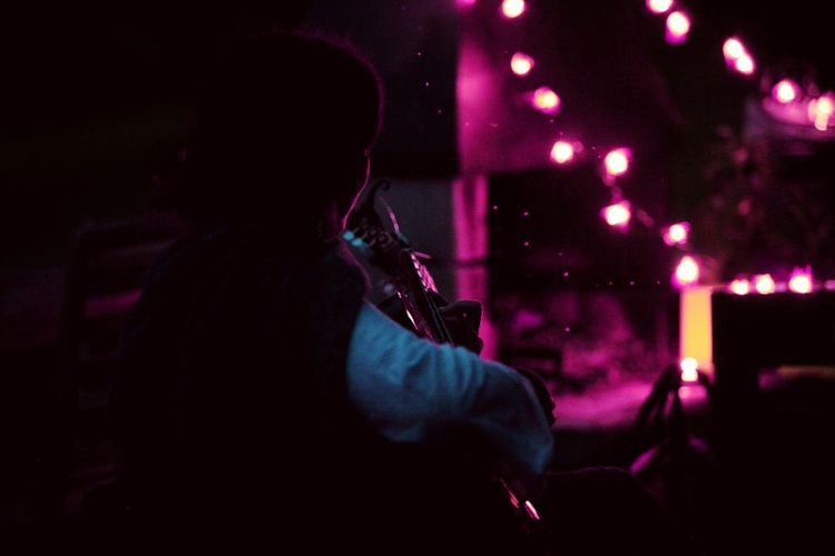 Night Nighttime Nightlife Outdoors One Person One Woman Only Guitar Guitarist Instrument Instruments Music Musician Lamps Ambient Light Ambience Sparks Sparks Flying Millennial Pink EyeEmNewHere Long Goodbye Art Is Everywhere Be. Ready. This Is Strength Exploring Fun