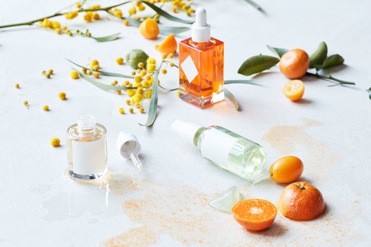High angle view of orange and fruits on table
