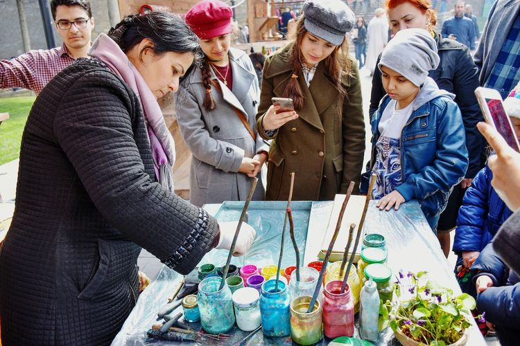Artist Watercolor Painting Water Colour Painting Painting On Water Warm Clothing People Group Of People City Women Outdoors Market Stall Market Streetphotography Togetherness Leisure Activity Colorful Multi Colored Winter Happiness Fun The Week On EyeEm See The Light Stories From The City Small Business Heroes Creative Space
