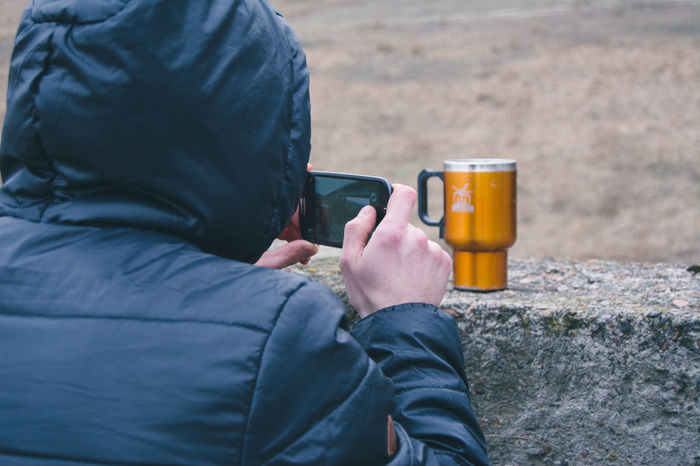 Mobile Conversations Human Meets Technology Photography Themes Portable Information Device Warm Clothing Outdoors From My Point Of View By Ivan Maximov Eyeem Photo Open Edit Communication Leisure Activity Wireless Technology