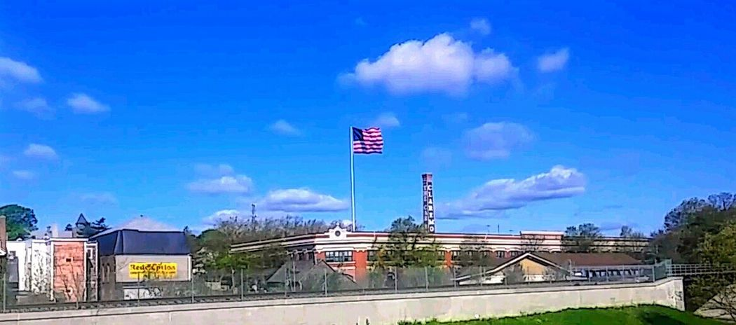 Flag Flags In The Wind  Flag Pole Sky Clouds And Sky Clouds Buildings & Sky Skyline City City Scape Wind Smoke StackBuildings Red White And Blue New England  Massachusetts New Bedford Building