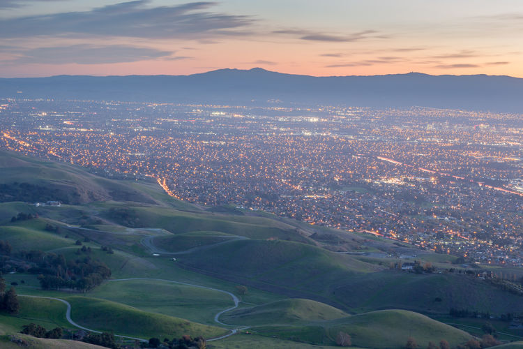 Silicon Valley and Green Hills at Dusk. Monument Peak, Ed R. Levin County Park, Milpitas, California, USA. Bay Area California Nature Northern California Rolling Hills Santa Cruz Mountains Travel Aerial View Dusk Dusk In The City Hill Illuminated Landscape Mission Peak Mountain Outdoors San Francisco Bay Area Santa Clara Scenics Silicon Valley Sky Technology Travel Destinations Valley Valleys