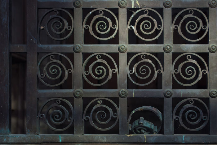 Bronze Cemetary Creepy Crypt Design Door Geometry Metal No People Order Ornate Pattern Repetition Spiral Tomb