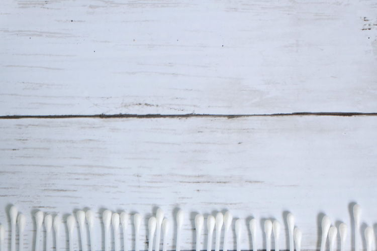 Cotton buds or cotton swab on white wooden background with copy space for text or logo. Cotton Bud Cotton Swab White Healthcare And Medicine Healthcare Hygiene Earwax Cleanliness Object Copy Space Wooden No People Backgrounds Close-up Indoors  Day