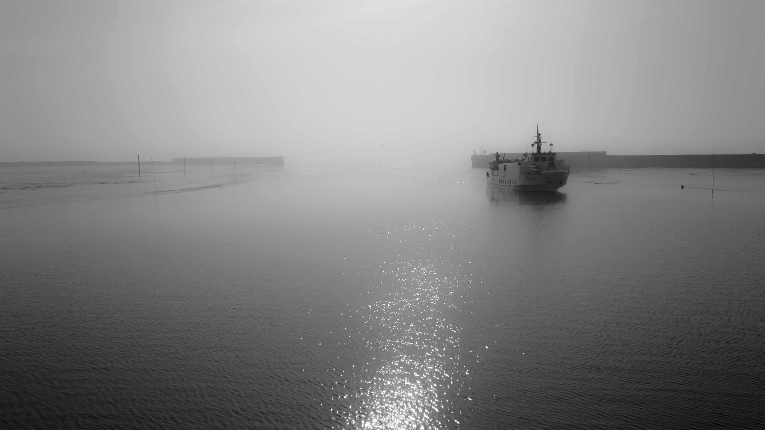 water, nautical vessel, sea, transportation, mode of transportation, sky, tranquil scene, ship, nature, no people, tranquility, waterfront, scenics - nature, beauty in nature, day, outdoors, fog, horizon over water, passenger craft