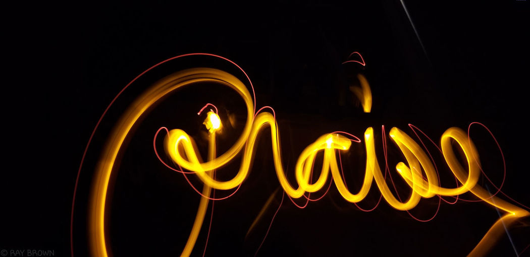 praise.,.. motivation to do anything Illuminated Neon Black Background Text Close-up Light Painting Capital Letter Written Handwriting  Western Script Long Exposure Alphabet Single Word Light Trail Information