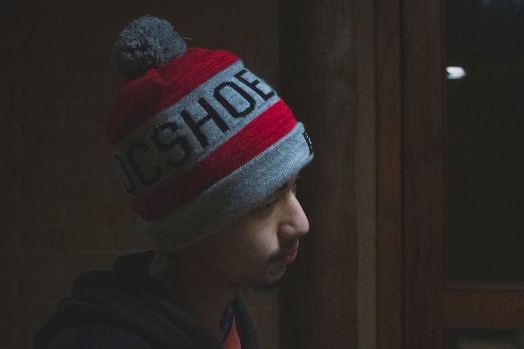 Close-up portrait of man wearing hat/cap