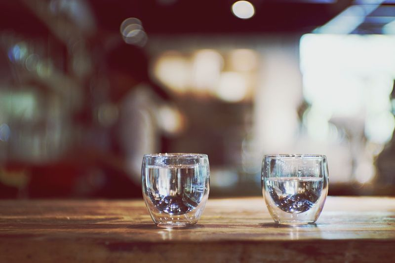 Close-Up Of Two Glasses On Table
