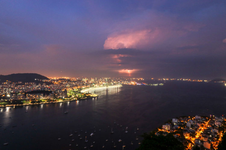 storm in río de Janeiro at Night Storm Storm Cloud Rays Of Light Rio De Janeiro Brazil Sea Cityscape City Cityscape Urban Skyline Illuminated Mountain Sunset Skyscraper Town Nightlife Cumulonimbus Thunderstorm Meteorology Dramatic Sky Extreme Weather Power In Nature