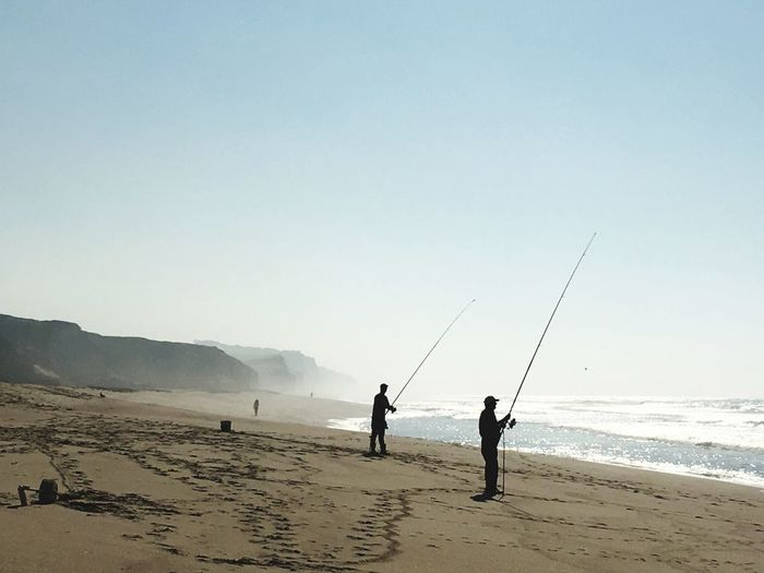 Beach Fishing... Beach Land Sky Sea Water Real People Sand Beauty In Nature Nature Clear Sky Men Scenics - Nature Leisure Activity Lifestyles Togetherness People Outdoors Horizon Over Water Day