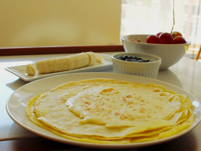 Close-up of crepes in plate on table