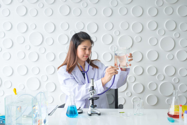 Doctor  Experiment Hospital Medicine Research Science Scientist Woman Biology Chemical Chemistry Clinic Concept Equipment Fish Laboratory Medical Microscope People Scientific Stethoscope  Technology Veterinary