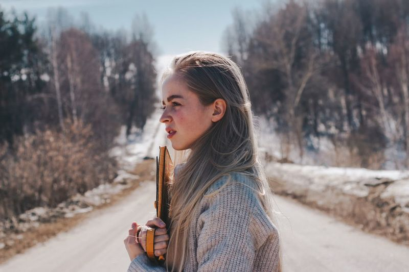 9 апреля. BMW EyeEm Selects One Person Winter Real People Lifestyles Warm Clothing Cold Temperature Young Adult Leisure Activity Focus On Foreground Plant Tree Portrait Clothing Outdoors Field Nature Day Land Snow Scarf
