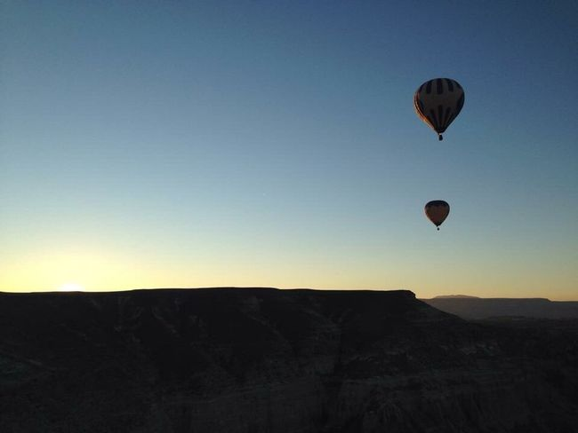 Hot Air Balloon Mid-air Nature Flying Adventure Landscape Tranquil Scene Mountain Scenics Sky No People Sunset Outdoors Ballooning Festival Balloon Beauty In Nature Clear Sky Day