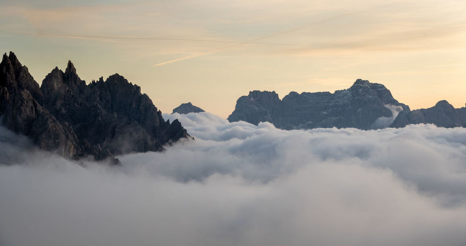 Scenic view of mountains against sky during sunset. tre cime dolomite italy