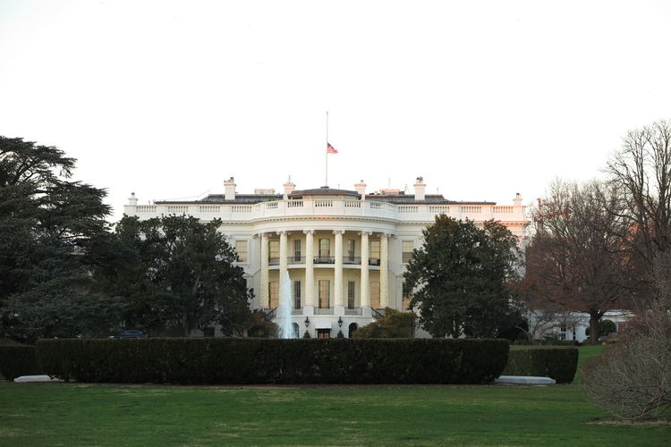 Architecture Building Exterior Built Structure Capital City Clear Sky Day Flag Government Grass No People Outdoors Patriotism Politics Politics And Government President Sky TheWhiteHouse Tourism Travel Travel Destinations Uscars Washington, D. C.