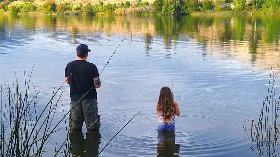 Fishing with the best daughter ever! Water Fishing Rod Fishing Standing Tranquility Nature Togetherness Lifestyles Leisure Activity Lake Tranquil Scene Daddy's Girl Daddy Daughter Time Daddyslittlegirl