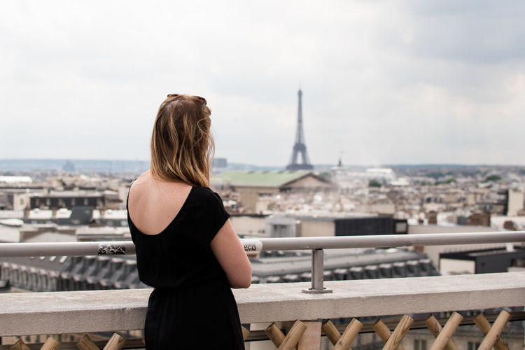 Adult Alone Let's Go. Together. Millenials NOMAD Paris Solo Traveler! Trip City Cityscape Europe Hair Hairstyle Leisure Activity Lifestyles On The Road Outdoors Railing Real People Rear View Sky Solo Travel Standing Water Women