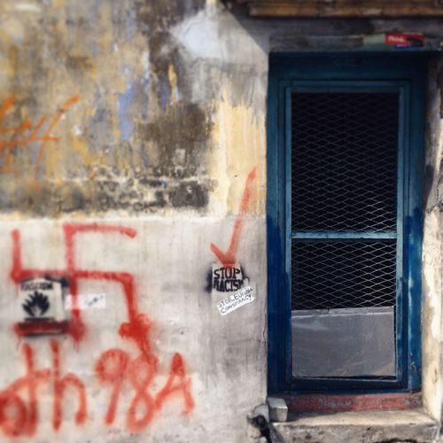 My Unique Style Streetphotography Penang Graffiti Swastica Good Fortune Stop Racism Racism Graffiti Messages Blue Door