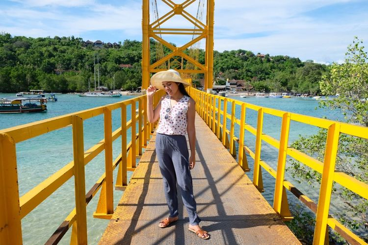 the yellow bridge Yellow Bridge Architecture Beach Ootd Bali Life Built Structure Balinese Tree Full Length Young Women Women Standing Bridge - Man Made Structure Portrait Railing Sky Cloud - Sky Footbridge A New Beginning EyeEmNewHere This Is Natural Beauty