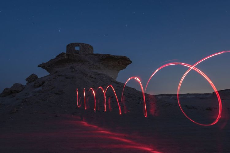 Painting with Light at Desert Darkness Night Sky Illuminated Nature Land Long Exposure Capture Tomorrow No People Star - Space Scenics - Nature Rock - Object Rock Light Painting Beauty In Nature