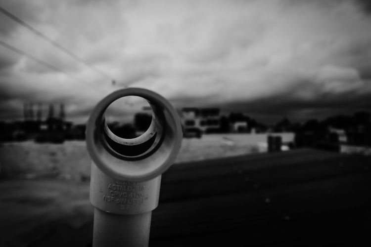 Close-up of bottle against sky