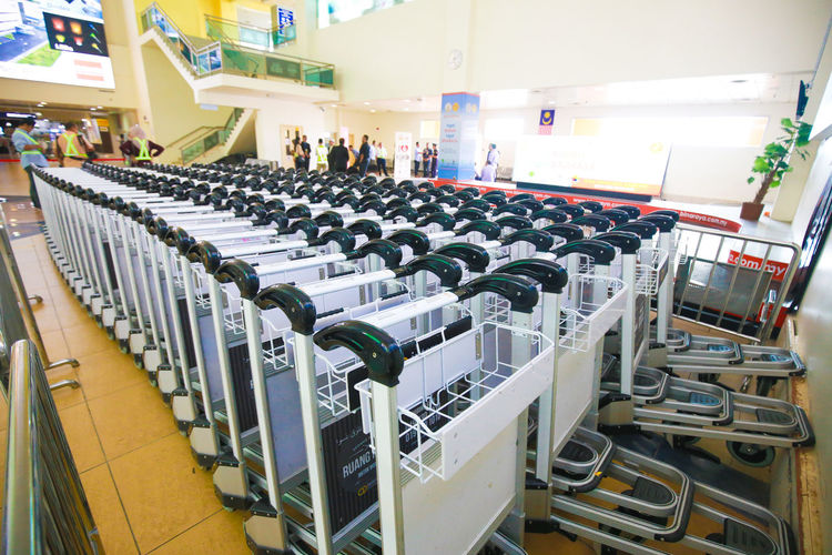Trolley Indoors  Technology Absence Seat No People Order In A Row Large Group Of Objects Arrangement Repetition Abundance Business Empty Side By Side Chair Collection Machinery Shopping Bottle Focus On Foreground Trolley
