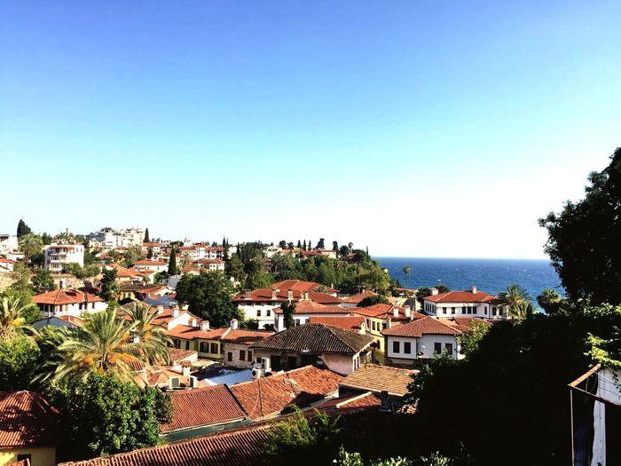 Antalya Cityscape By Sea Against Clear Blue Sky