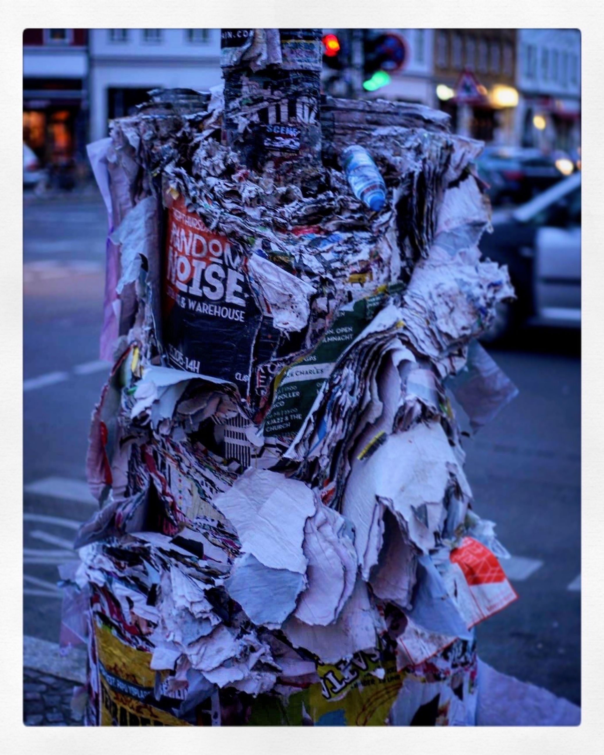 transfer print, auto post production filter, art and craft, human representation, art, creativity, statue, animal representation, sculpture, day, close-up, focus on foreground, outdoors, incidental people, no people, street, bird, text