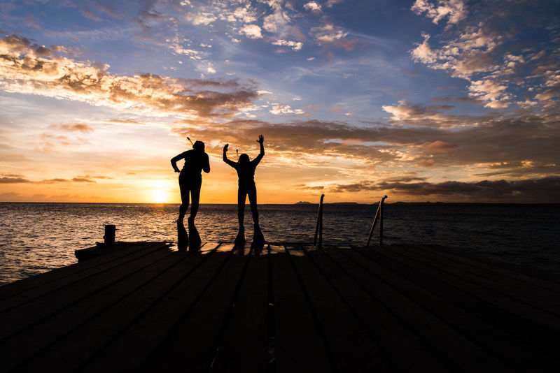 Jumping off the pier with a beautiful sunset Family Holiday Ocean View Vacations Beauty In Nature Cloud - Sky Day Friendship Full Length Horizon Over Water Leisure Activity Men Nature Outdoors People Real People Scenics Sea Silhouette Sky Sky Scape Standing Sunset Togetherness Water Connected By Travel Second Acts
