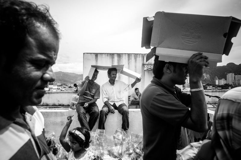 Rohingya refugee sheltering from the scorching heat of the sun. Fate  Holding Malaysia Man Made Object Memories NGO Outdoors Paper Box Refugee Rohingya Shelter Sky Stone Material Unhcr