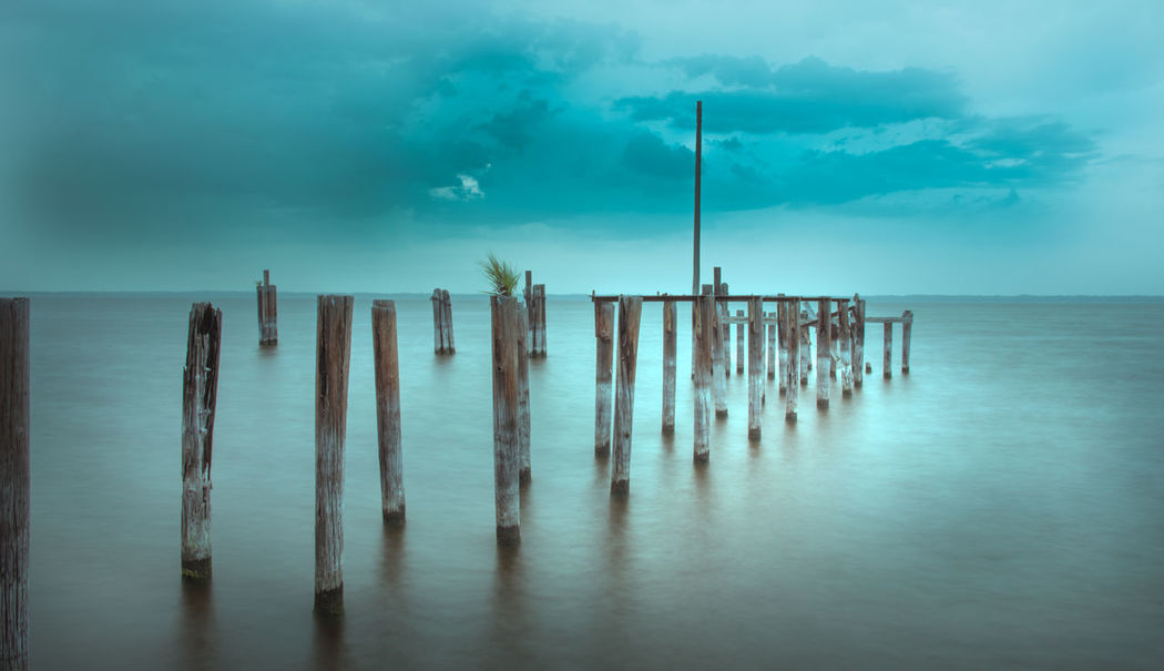 Beauty In Nature Cloudy Sky Dock Dramatic Sky Dusk Florida Sky Lake Lake Monroe Lake Pier No People Pier Pole Sanford Florida Scenics Sky Soft Water Tranquile Scene Tranquility Water Waterfront Wooden Post First Eyeem Photo