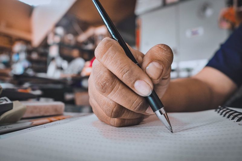 One Person Indoors  Human Body Part Human Hand Focus On Foreground Hand Art And Craft Close-up Holding Real People Body Part Creativity Adult Occupation Men Lifestyles Skill  Midsection Human Limb Pen