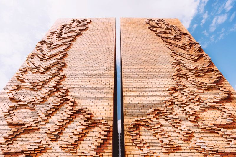 Low angle view of carving on wood against sky