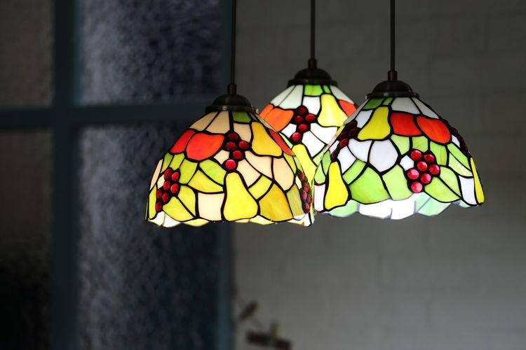 Illuminated pendant lights hanging at home