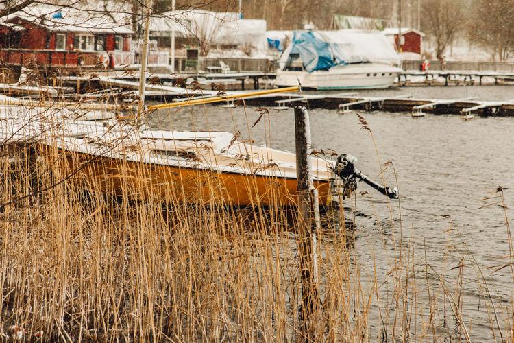Nautical vessel moored in lake