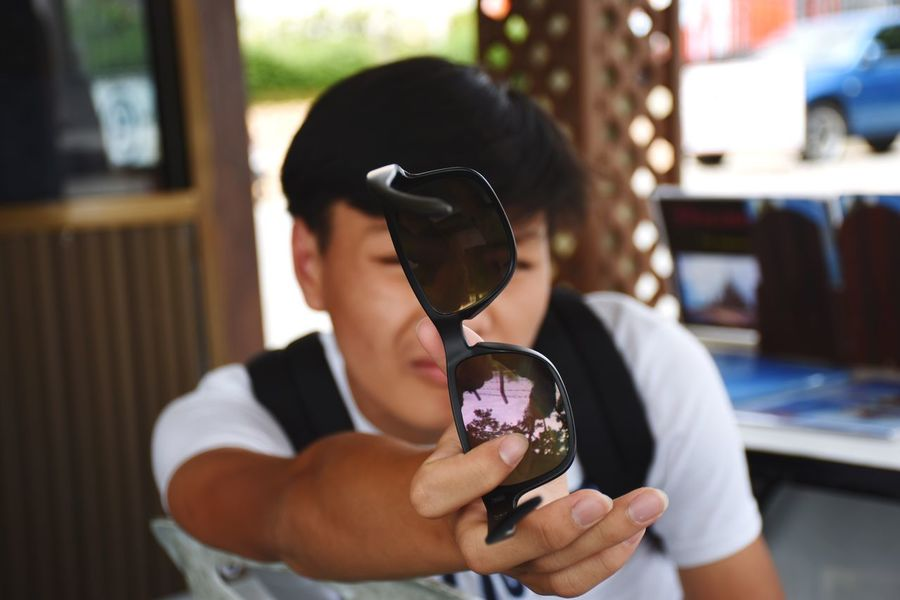Sunglasses are a must when sunny days attacks! Sunglasses Young Adult Young Men Man Summer Summertime Holiday Sunny Sunny Day Warm Sunglasses :) Glasses Enjoying Life Show Hot Day Thailand Pattaya Having Fun Noface Bokeh