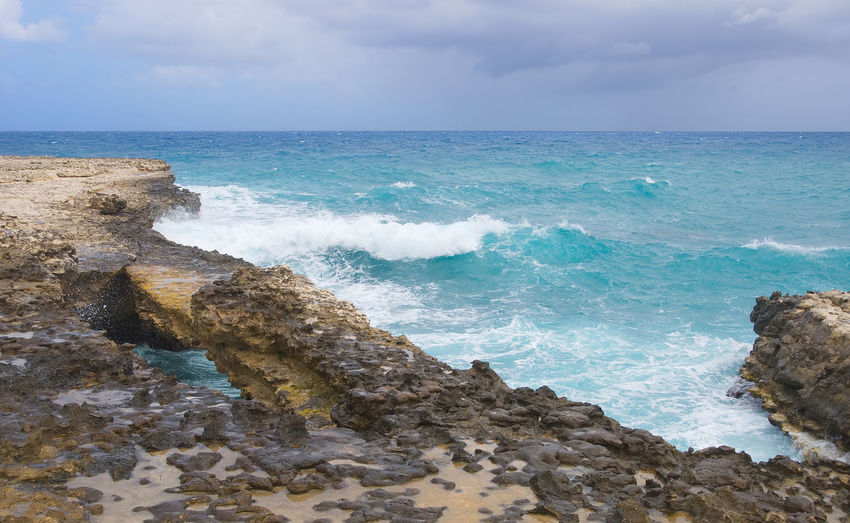Devil's Bridge bay - Caribbean tropical sea - Antigua and Barbuda Antigua Antigua And Barbuda Atlantic Cloud Devil Rock Wave Beach Beauty In Nature Bridge Caribbean Cloud - Sky Devils Bridge Horizon Over Water Nature Ocean Outdoors Paradise Scenics Sea Sky Tranquil Scene Tranquility Tropical Water