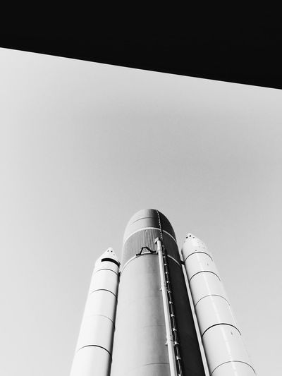 Shuttle. Low Angle View Architecture Built Structure Building Exterior Industry Clear Sky Tower High Section Skyscraper Tall - High Sky Tall Industrial Building  Backlit Curve No People Spire  Space Space Shuttle NASA Space Exploration Majestic Exploration Monochrome Photography
