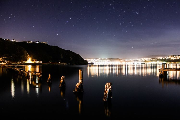 Shelley Bay by night Reflection Night Water Tranquil Scene Illuminated Tranquility Scenics Mid Distance Waterfront Calm In A Row Blue Beauty In Nature Sky Majestic Nature No People Lit Outdoors Mountain Range