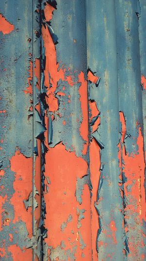 Red Damaged Wall - Building Feature Full Frame Built Structure Peeling Off Weathered Deterioration Run-down Backgrounds Close-up Architecture Peeled Blue Bad Condition Day Obsolete Peeling No People Vibrant Color Wall