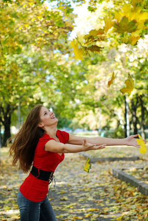 Woman and autumn Autumn Beautiful Woman Close-up Day Fall Freshness Happiness Holding Human Hand Leaf Leisure Activity Lifestyles Long Hair Nature One Person One Woman Only One Young Woman Only Outdoors People Real People Side View Smiling Tree Young Adult Young Women
