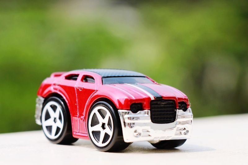 EyeEm Selects Car Mode Of Transportation Transportation Red Motor Vehicle Toy Car Toy Racecar Sports Car Land Vehicle Focus On Foreground Outdoors Wheel Selective Focus