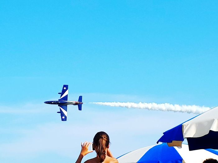 Airplane Sky Flying Clear Sky Transportation Day Blue Outdoors Airshow Adult Low Angle View One Person Air Vehicle Frecce Tricolori Clear Sky Beach The Week On EyeEm
