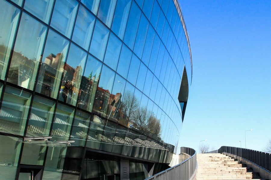 The walls of the old Wawel Castle reflected in the glass of a modern building Architecture Blue Building Built Structure City City Life Day Development Envision The Future Glass Low Angle View No People Outdoors Reflection Sky Wawel  Wawelcastel Reflection_collection