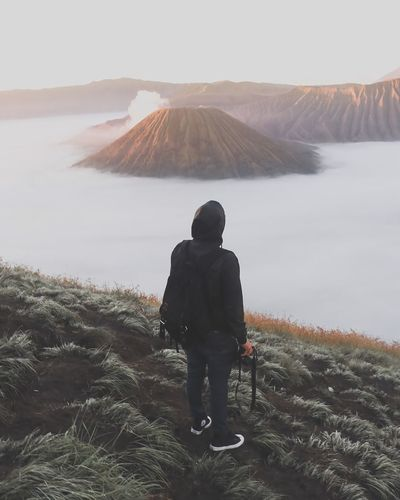 BROMO🗻🗻 Full Length Men Rear View Warm Clothing Awe Sky Volcanic Landscape Hiker Volcanic Crater Erupting Volcano Geyser Kilauea Volcanic Rock Hot Spring Active Volcano Volcanic Activity Sulphur Foggy Bromo-tengger-semeru National Park East Java Province Lava Java Ash It's About The Journey